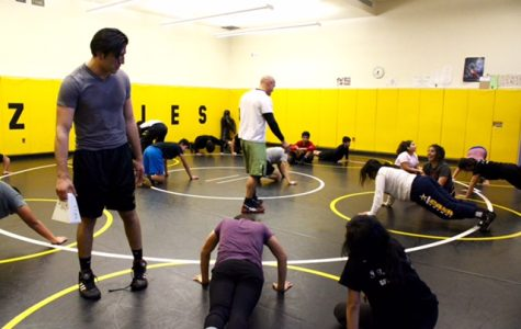 Coach, Hector Maldonado coaching the GFHS Boys and Girls  wrestling while practicing to succeed in this winter season.