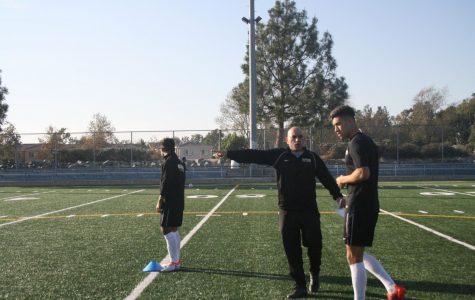 Coach Fernandez (center) coaching his team at the Centennial Stadium.
