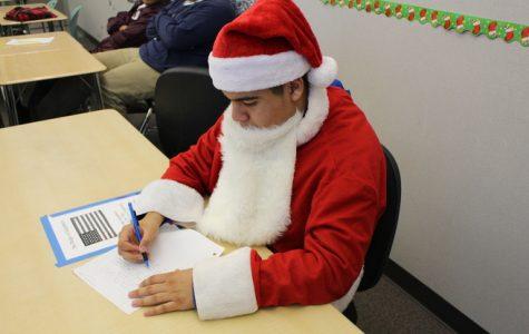Santa aka Alex Reyes, our staff writer, making his own Christmas list.