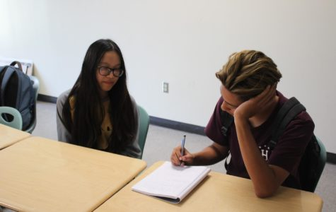 Two GFHS Film Club members negotiating in which film they will be watching next.