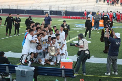 The Godinez boy's soccer team poses for their winning picture after they won State Regional Champs.