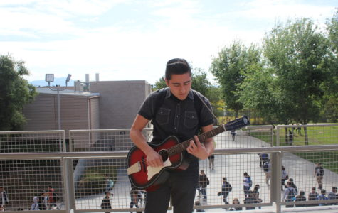 Joseph Reyes playing a quick blurb of his favorite song during passing period.