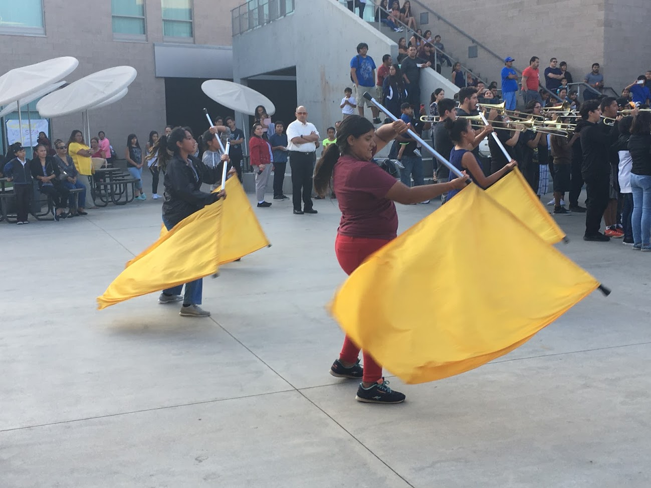 Color Guard show off their hard work and dedication to the team while the brightly colored flags catch people's attention.