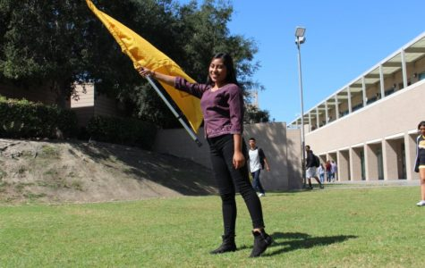 Breanna Figueroa, seen here posing with a flag.