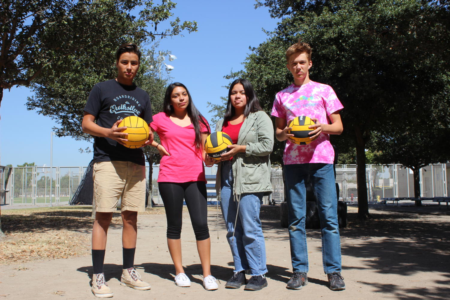 From left: Varsity waterpolo captain Anthony Sanchez, water polo players Andrea Muniz, Paulina Calderon and JV waterpolo captain William Feuerborn hope to see the area behind them built into a pool.