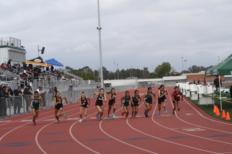 Godinez girls varsity start their 800m race against Costa Mesa High School.