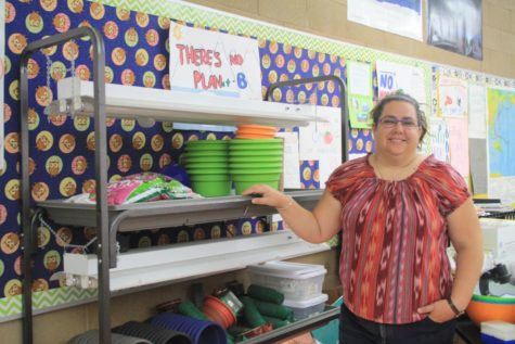 Teacher Jill Lytle standing next to items bought from fund-raised money for AP Environmental.