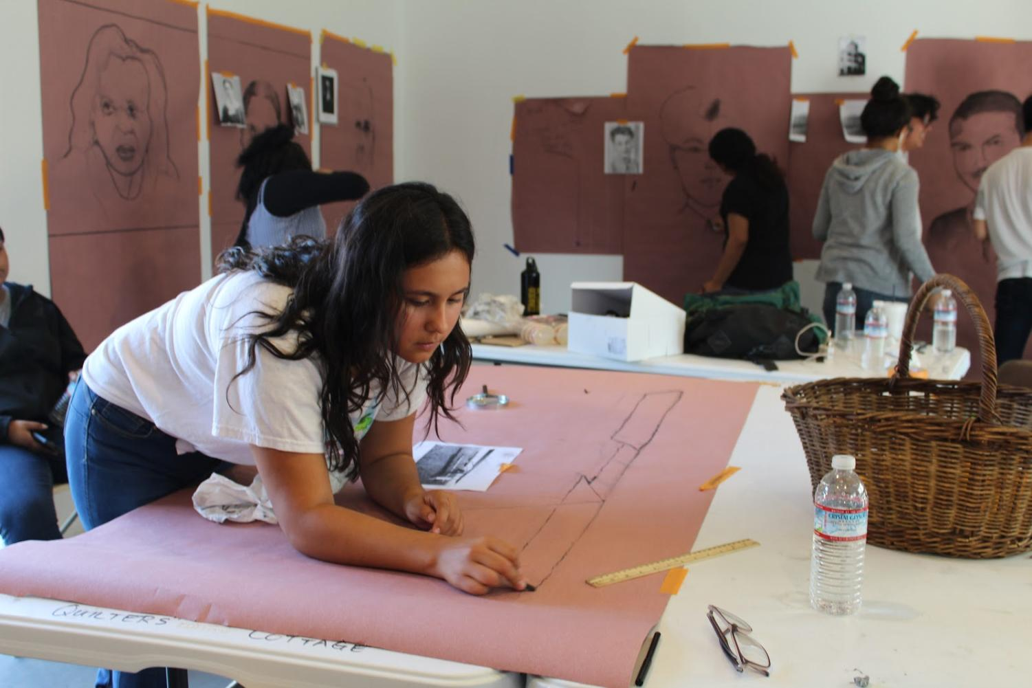 Katrina Mena, a sophomore at Godinez Fundamental High School, working on her perspective drawings for the mural on Tuesday, Sept. 25, 2018.