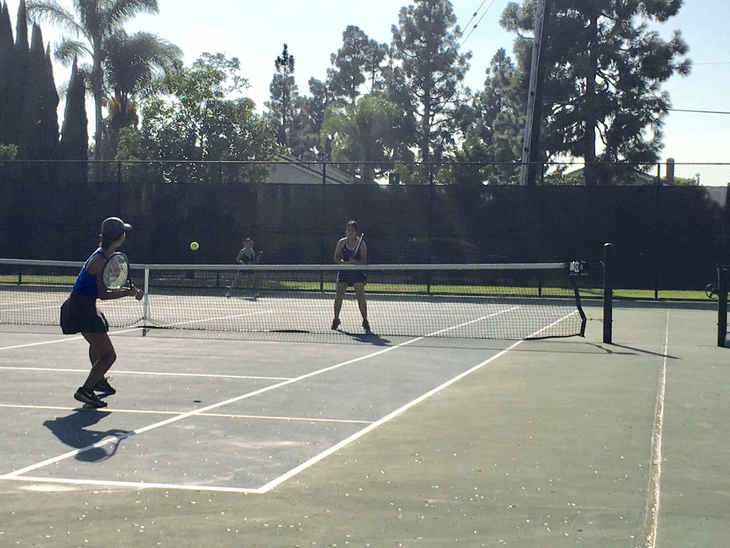 From left to right, Western High School athlete plays against Samantha Tapia and Donna Tran at the McFadden Middle School tennis court on Tuesday, Sept. 25, 2018.