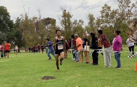 Varsity Cross Country Adalberto De Jesus runs at a track meet at Godinez Fundamental High School in Sept.