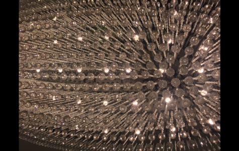 At Santa's Buffet and Grill there is a beautiful chandelier hanging from the ceiling.