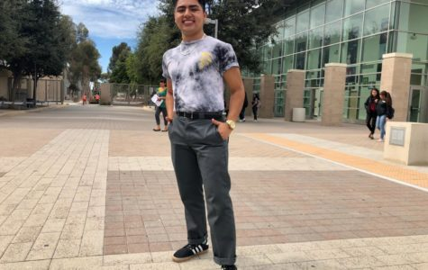 Luis Betancourt, junior at Godinez Fundamental High school, wearing a tie dye shirt along with loose/tight fitted jeans. Oct. 01, 2018.