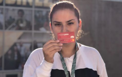 Reporter Katty Gallegos shows what her MoviePass looks like in front of Godinez Fundamental High School on Monday, Oct. 1, 2018.