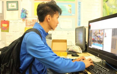 Senior Ky-anh  Ho searching up tutorials after his first look at TAG's raspberry pi robots
