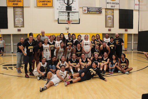 Alumni and varsity team united on the basketball court after game at Godinez at  9 p.m.