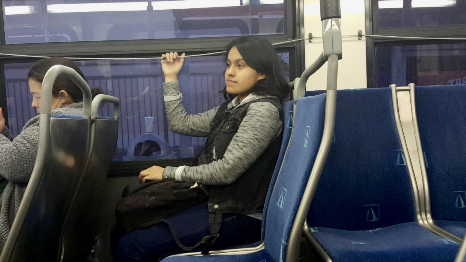 Michelle Martinez riding the bus after school is glad that the bus isn't full. Photo taken at 4:40 p.m. Dec. 3, 2018.