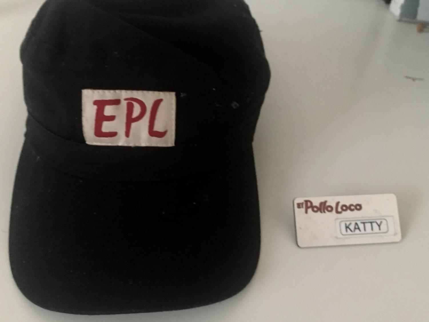 Reporter Katty Gallegos shows part of her El Pollo Loco work uniform on January 31, 2019.