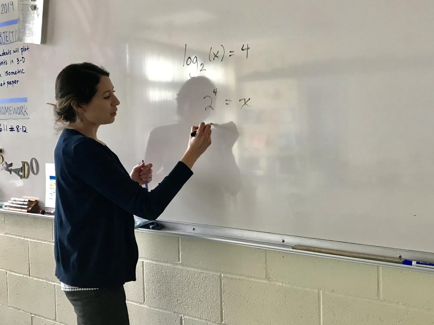 Ms. Prado demonstrating a lesson students are currently learning in class.