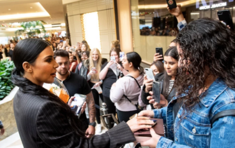 Kim Kardashian West signs an autograph for Cynthia Molina at the opening of Kardashian West's pop-up store, KKW, at South Coast Plaza in Costa Mesa, CA on Tuesday, December 4, 2018.