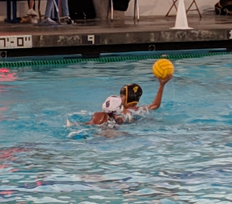 Freshman, Stephanie Hidalgo, playing a nightly game of water polo.