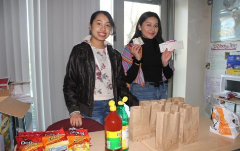 Alexa Penaloza and Britney Vargas setting up the snack bar before the movie starts.
