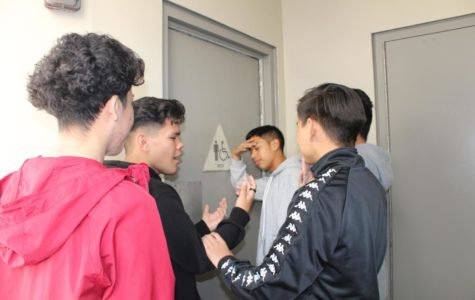 Left to right: Alex Mendoza, Angel Manzo, Anthony Canche, Giovanni Bello, Mario Campos outside of the locked men's restroom.