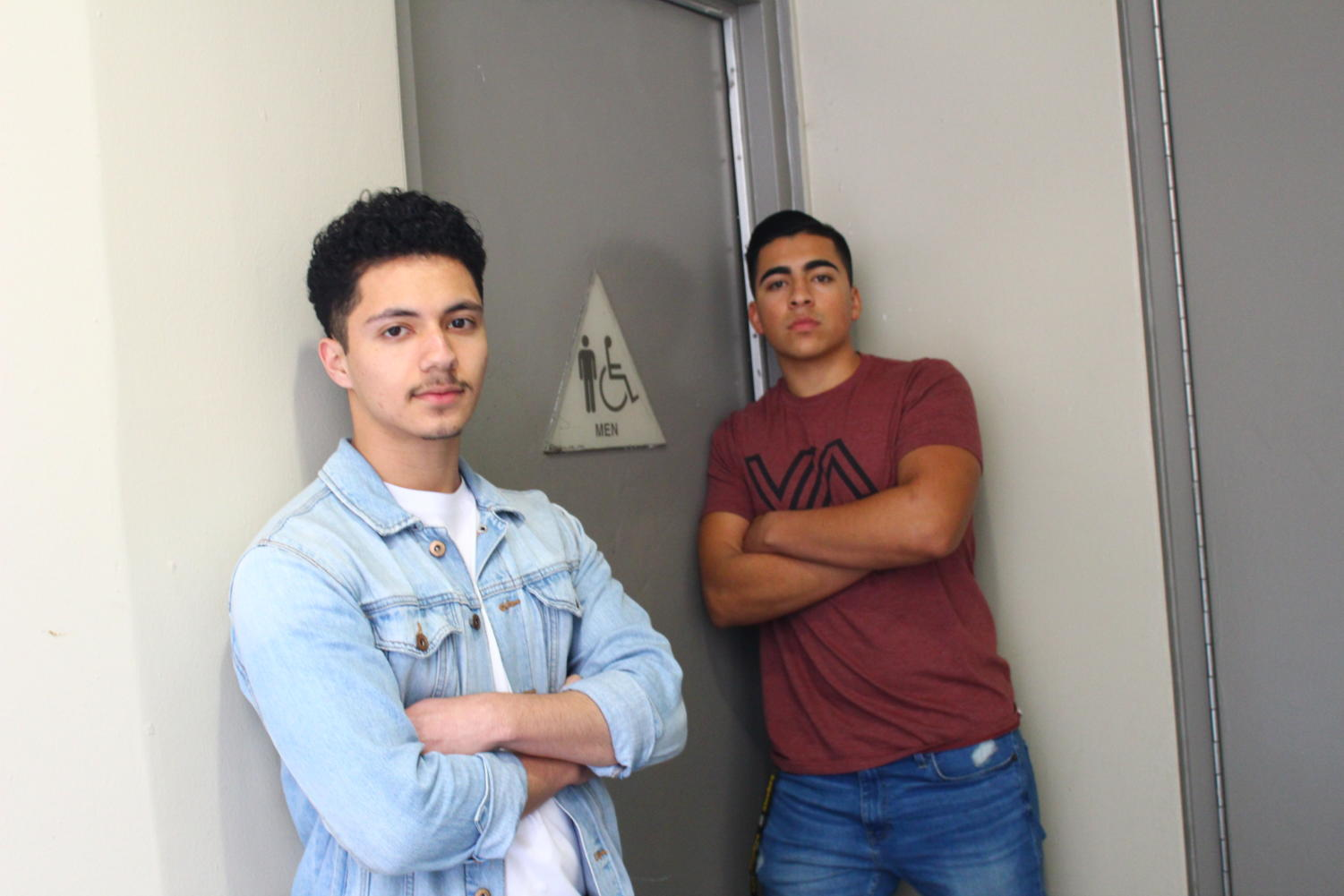From left: guest contributors Joshua Garcia and Jesse Cendejas in front of one of the many restrooms locked during class time. Photo taken March 26, 2019 during 5th period.