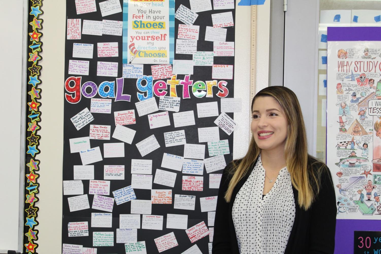 Math teacher Claudia Valencia, standing in front of her classroom, March 6th, 2019. Godinez Fundamental.