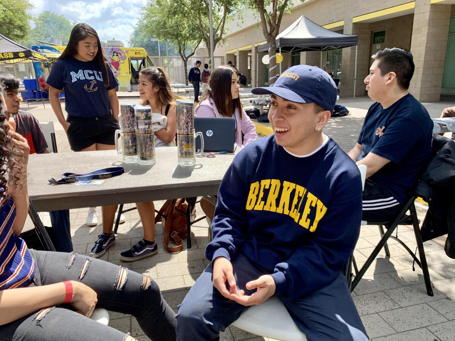 Senior, Fabian Mendoza, sports his school choice at the GFHS Signing Day and Senior Picnic. Photo taken on Friday, May 17, 2019 on Grizzly Way at Godinez Fundamental High School.