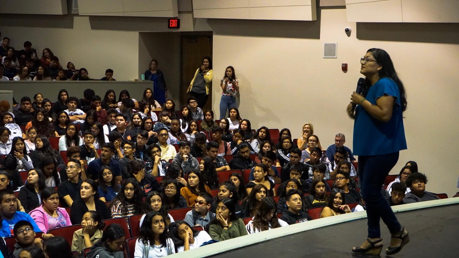 """""""The Distance Between Us"""" Author, Reyna Grande is seen answering a question by a Godinez Fundamental High School student."""