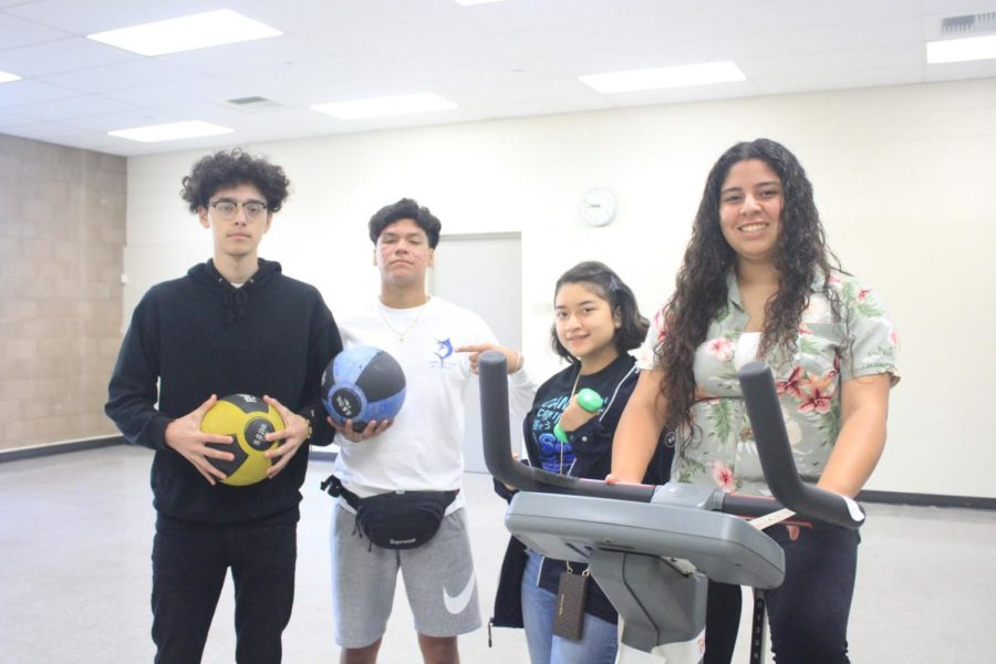 From Left to Right: Seniors and Journalists Erick Pompa, Roman Arcos, Susana Leon, and Cynthia Molina patiently wait for the new equipment to arrive in the workout room located at the bottom floor of building 1.