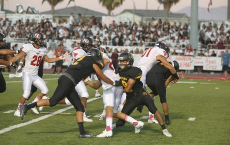 The Godinez Varsity Football Team playing against Segerstrom at the annual rivalry game on August 30.