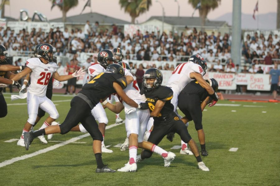 The+Godinez+Varsity+Football+Team+playing+against+Segerstrom+at+the+annual+rivalry+game+on+August+30.
