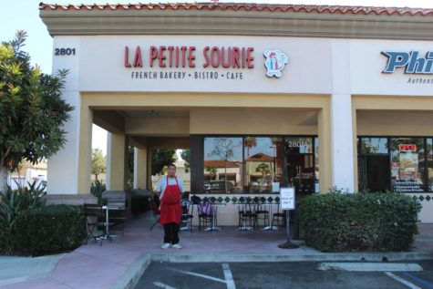 La Petite Sourie, employee Caesar stands outside the restaurant.