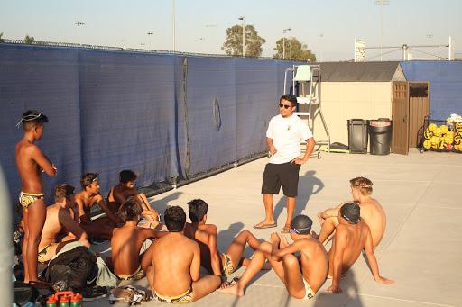 Coach Misael Cruz motivates his team before their game against the Garden Grove Argonauts.
