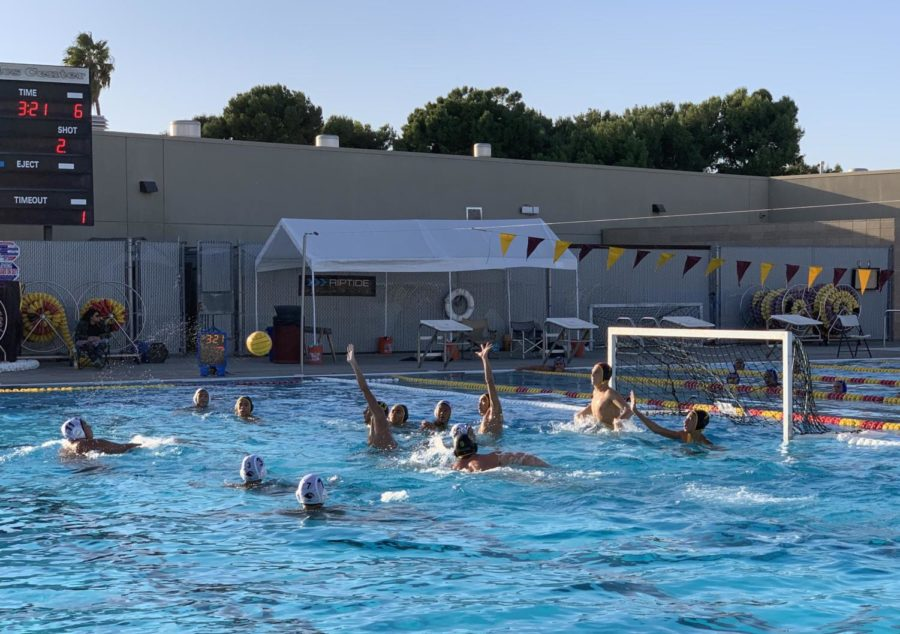 Boys+waterpolo+goalie+Will+Feuerborn+gets+ready+to+block+a+shot+with+the+help+and+arms+up+of+his+teammates+from+left+Charles+Luevano%2C+Wilton+Phung+and+Mekhi+Jones.