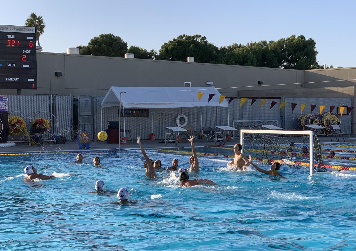 Boys waterpolo goalie Will Feuerborn gets ready to block a shot with the help and arms up of his teammates from left Charles Luevano, Wilton Phung and Mekhi Jones.