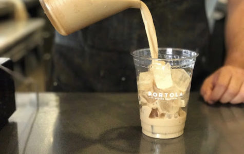 Portola Coffee Lab barista pours their specialty iced coffee into a cup. The owner was too busy to give him name since they were short-staffed that day. Photo given on Weds., Nov. 6, 2019.