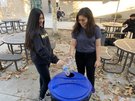 Presidents of the Environmental Club (From left) Angelica Corarrubias-Cardan and Valerie Farias. throw their recycled bottles in the correct recycling bin, November 21