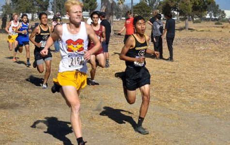 Alan Rodriguez (right) runs to finish his race.