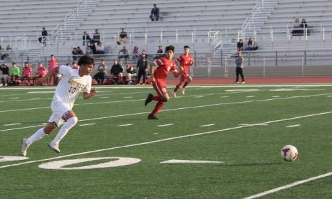 Josue Martinez on the run vs. Garden Grove on Friday, January 24th. Garden Grove High School
