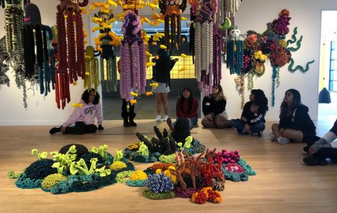 AP art students sit and observe the art piece that represents a coral reef at the Orange Coast Museum of Art on Friday, January 31, 2020.