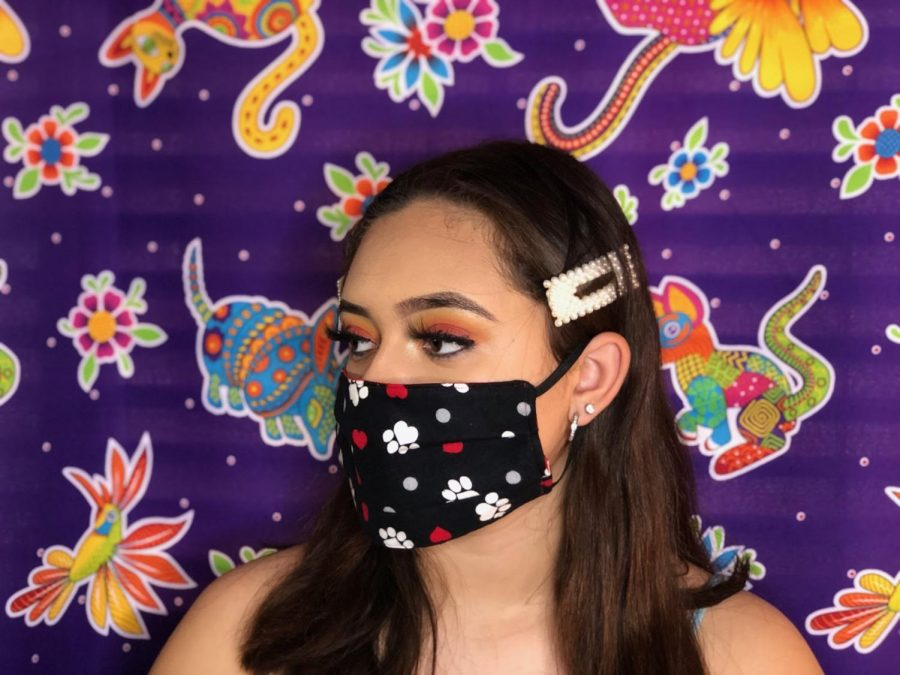 GFHS student, Karyme Iniguez, models one of the masks that she and her mom make. Photo taken April 16, 2020 at 6:25 p.m.
