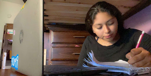 After finishing her chores, freshman America Bernabe works on her Geometry homework at her desk in her room. Picture taken March 24, 2020, at 7:25 p.m.