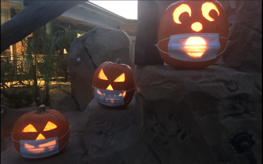 Some pumpkins that are carved, decorated and masked for Halloween. Photo taken on October 11, 2020 in Santa Ana, Calif.