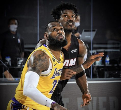 LeBron James from the Los Angeles Lakers backing down Jimmy Butler from Miami HEAT during one of the Finals games.
