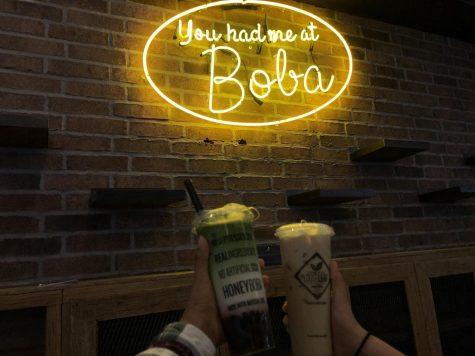Reporters Alonso and Cortez hold their yummy drinks  of Strawberry Matcha Latte and Banana Foster Milk at the new Loose Leaf Boba store in DTSA.