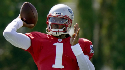 Former Carolina Panthers QB now first-year Patriots QB Cam Newton throwing the ball in practice before his COVID-19 diagnosis.