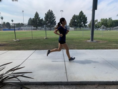 Junior Vanessa Flores runs at El Salvador park located in Santa Ana. Photo taken on October 5, 2020.