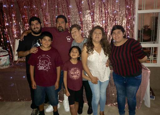 The author, Graciela Ramirez (far left) at a family celebration on July 20, 2019.